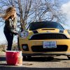 woman washing a car with Azure clean car and truck wash
